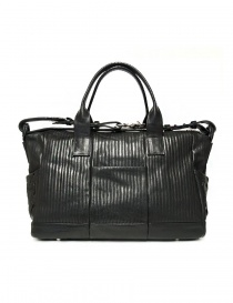 Cornelian Taurus by Daisuke Iwanaga black leather bag price