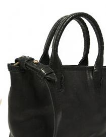 Cornelian Taurus by Daisuke Iwanaga black leather small bag price