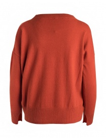 Yasmin Naqvi orange sweater