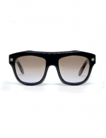 Glasses online: Paul Easterlin sunglasses with brown shaded lens
