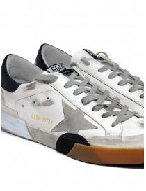 Sneaker Golden Goose Superstar bianca e nera con stella grigia calzature uomo acquista online
