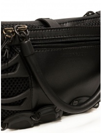 Innerraum black shoulder bag in leather, rubber and mesh bags price